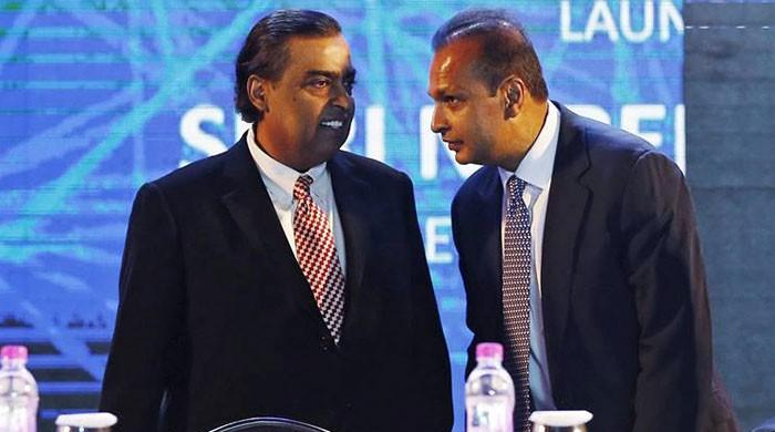 India's richest man helps tycoon brother avoid jail