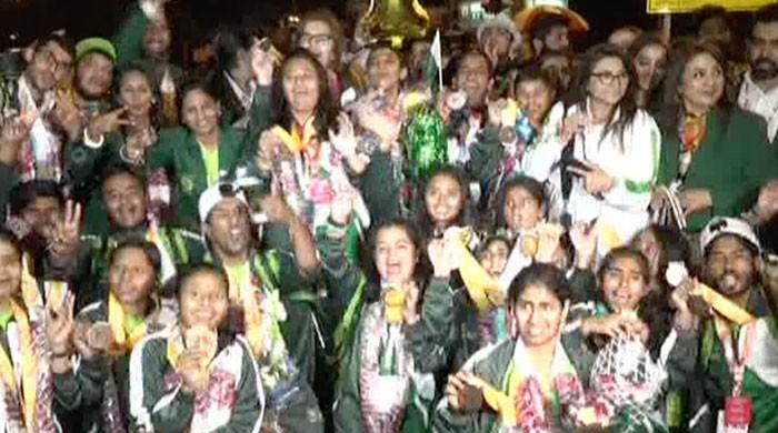 Pakistani athletes land in Karachi after Special Olympics World Games success