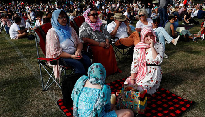 People attend a vigil for victims of the mosque shootings in Christchurch New Zealand