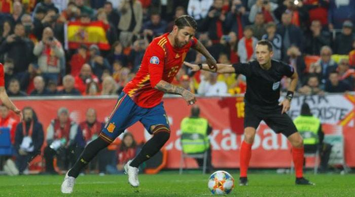 Ramos helps Spain edge Norway, Kean stars for Italy