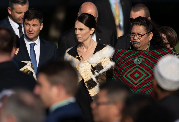 Prime Minister of New Zealand Jacinda Ardern (C arrives at the ceremony during a national remembrance ceremony at North Hagley Park in Christchurch, New Zealand, March 29, 2019. AFP/Marty Melville