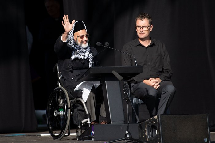 Survivor of the Al Noor Mosque attack, Farid Ahmed, waves to the crowds during a national remembrance ceremony at North Hagley Park in Christchurch, New Zealand, March 29, 2019. AFP/Marty Melville
