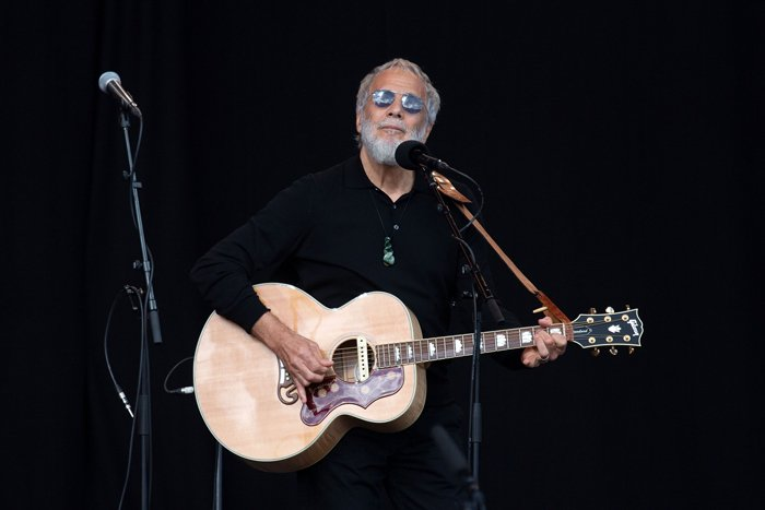 Yusuf Islam/Cat Stevens sings during a national remembrance ceremony at North Hagley Park in Christchurch, New Zealand, March 29, 2019. AFP/Marty Melville