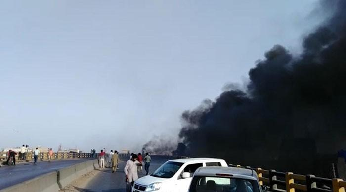 Oil tanker crashes, bursts into flames on Karachi's Gul Bai Flyover