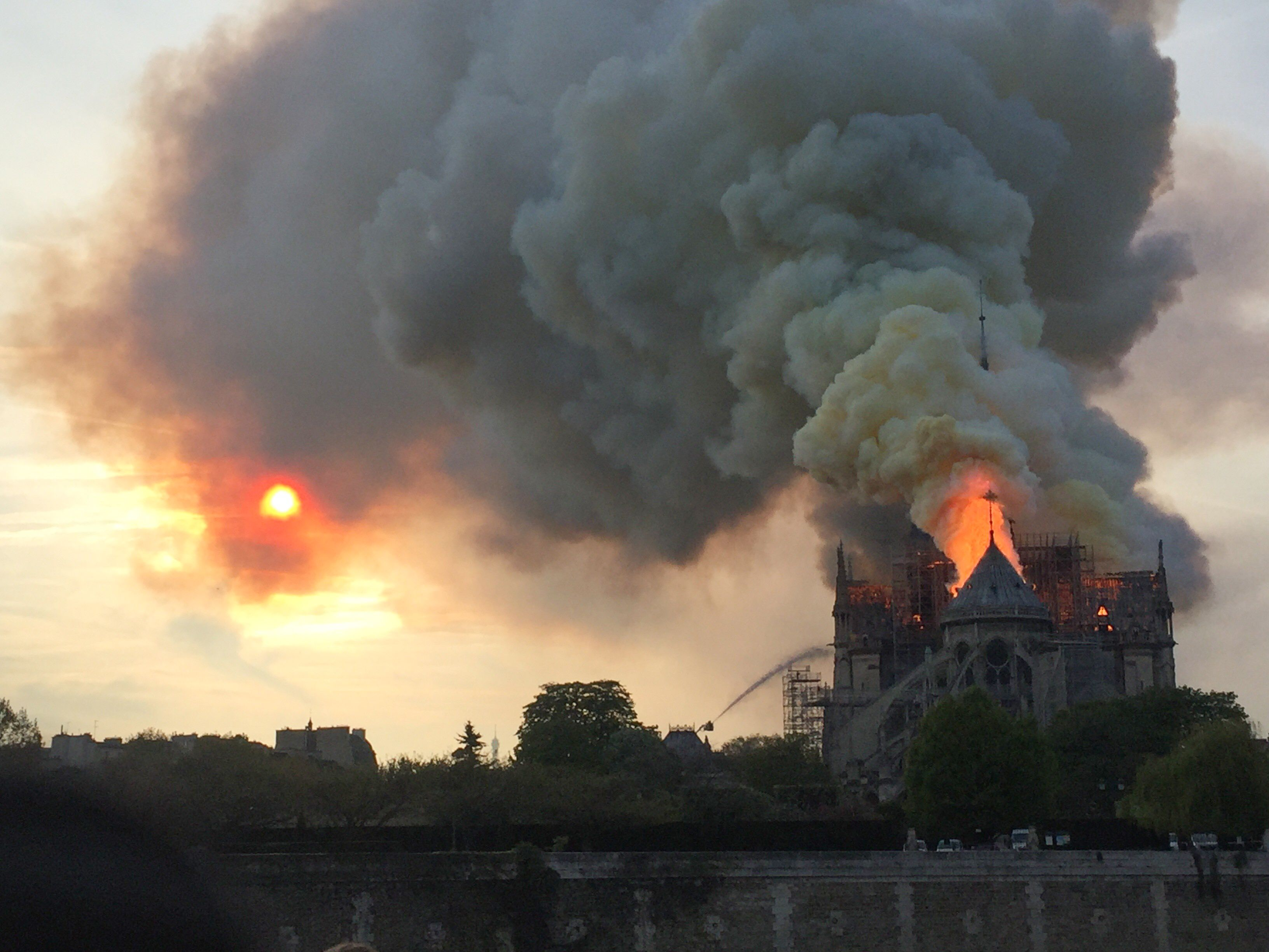 Smoke billows as flames burn through the roof of the Notre-Dame de Paris Cathedral on April 15, 2019. Photo: AFP