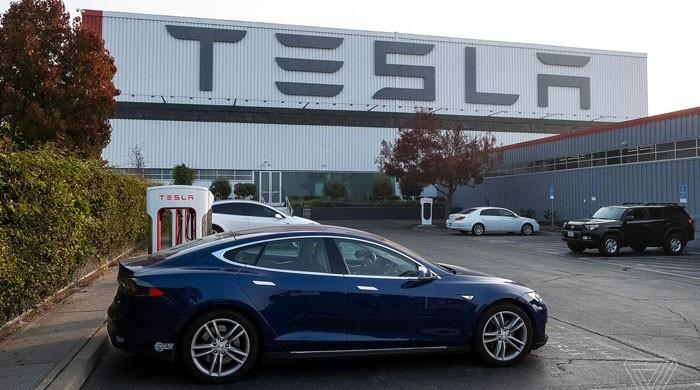 Tesla hit with big loss as car deliveries sputter