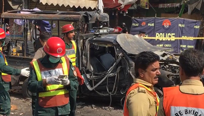 Police and rescue personnel at the site of the blast in Lahore