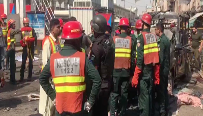 Police and rescue personnel at the site of the blast in Lahore.