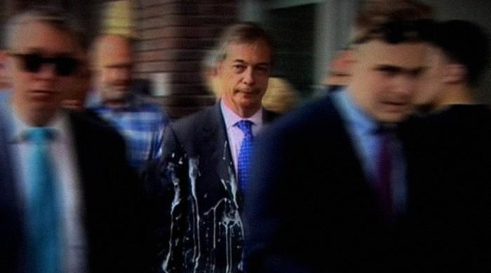 Brexit Party's Nigel Farage shaken but unhurt in milkshake attack