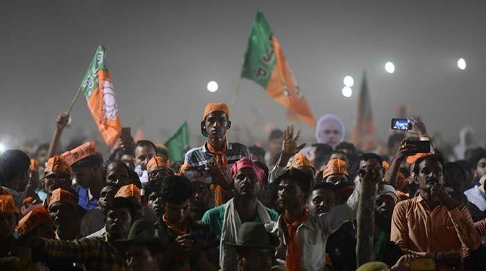 India shares hit record high over Modi election victory forecasts