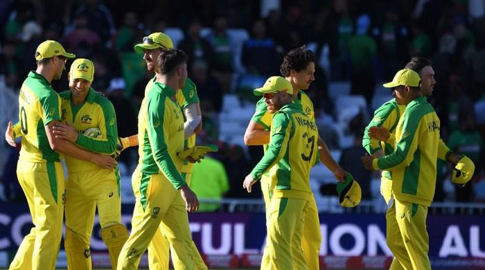Warner ton against Bangladesh sends Australia top of World Cup table