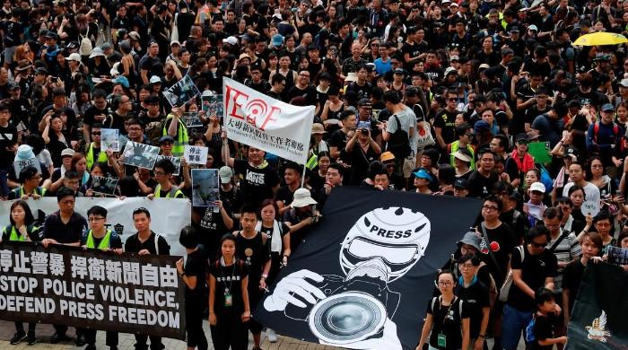 Hong Kong anti-extradition protesters fire up fight in suburbs
