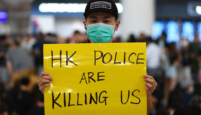 Pro-democracy protesters gather against the police brutality and the controversial extradition bill at Hong Kong´s international airport in Hong Kong, August 12, 2019. AFP/Manan Vatsyayana