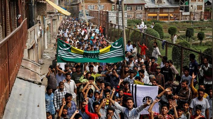 Besieged occupied Kashmir neighbourhood in test of wills with India's Modi