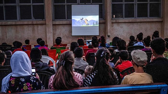 Mobile cinema brings movie magic to Syria's Kurd children