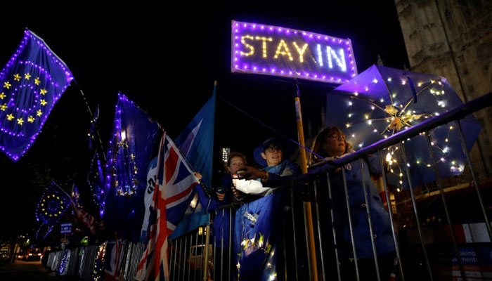 Anti-Brexit protesters demonstrate outside Parliament in London