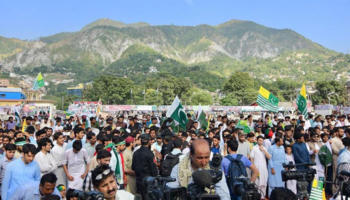 A crowd of people gathered in Muzafarabad, Azad Jammu and Kashmir.—Photo courtesy: Facebook/PTI Official