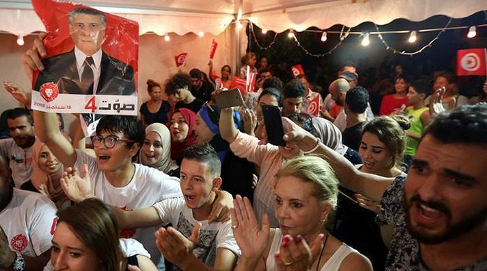 Anti-establishment figures claim first round wins in Tunisia polls