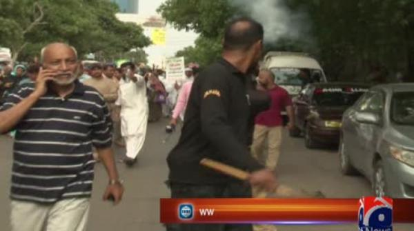 Multiple protesting teachers injured as police use tear-gas, water cannon in Karachi