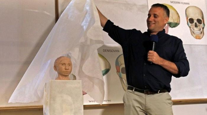 Scientists unveil appearance of ancient human relative
