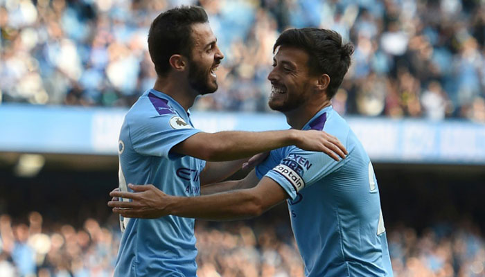 Manchester City's Bernardo Silva celebrates with David Silva during their thrashing of Watford