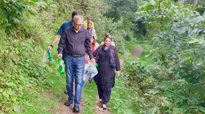 President Arif Alvi spotted picking up trash during hiking trip