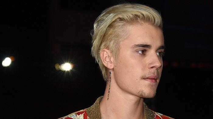 Justin Bieber sued for posting a picture of himself