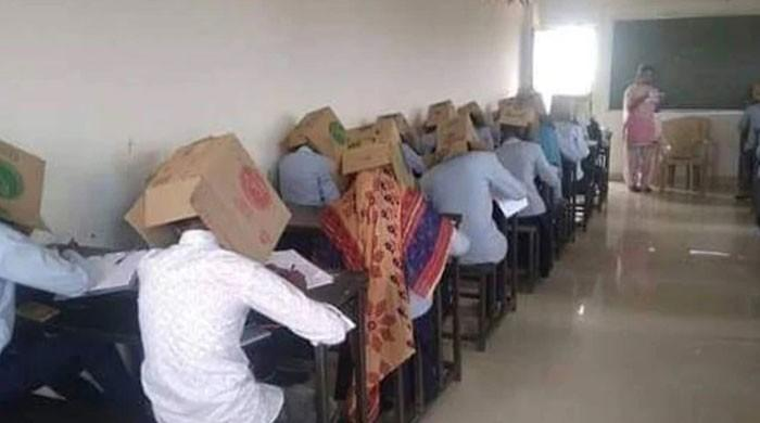 Indian students forced to wear cardboard boxes on their heads to stop cheating during exams