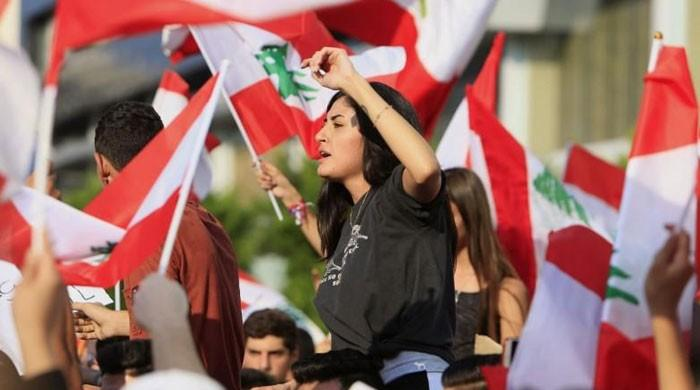 Tens of thousands protest in Lebanon for third day