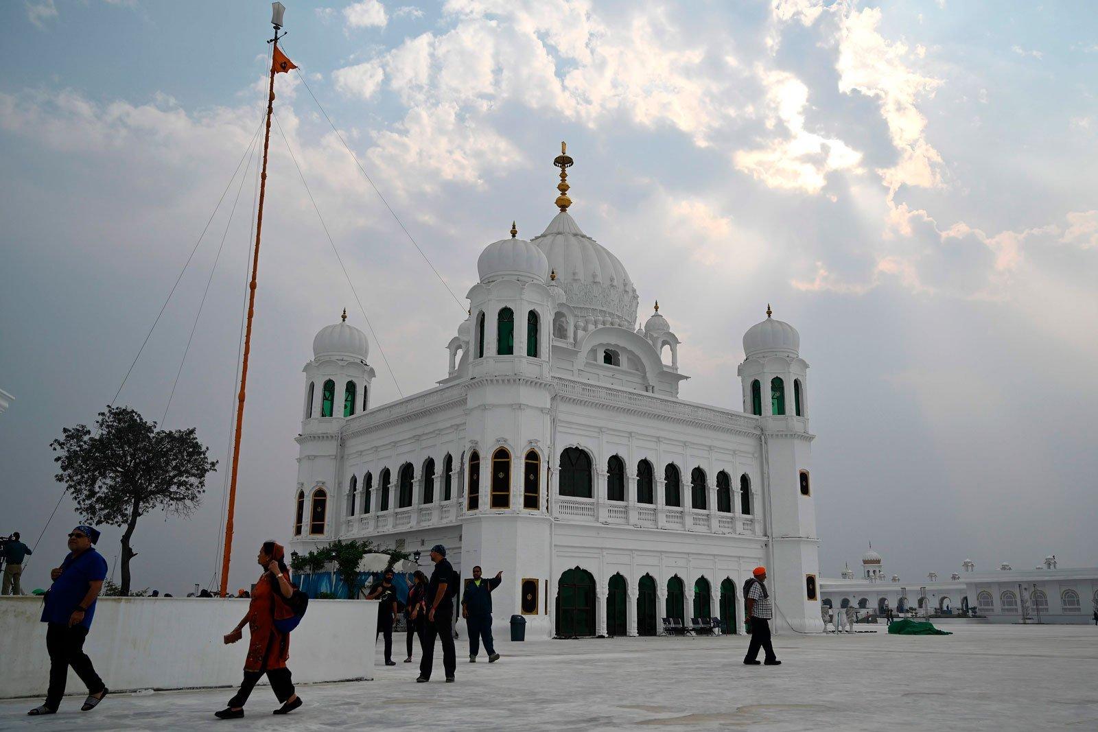 Sikh pilgrims from different countries visit the Shrine of Baba Guru Nanak Dev at the Gurdwara Darbar Sahib — AFP photo