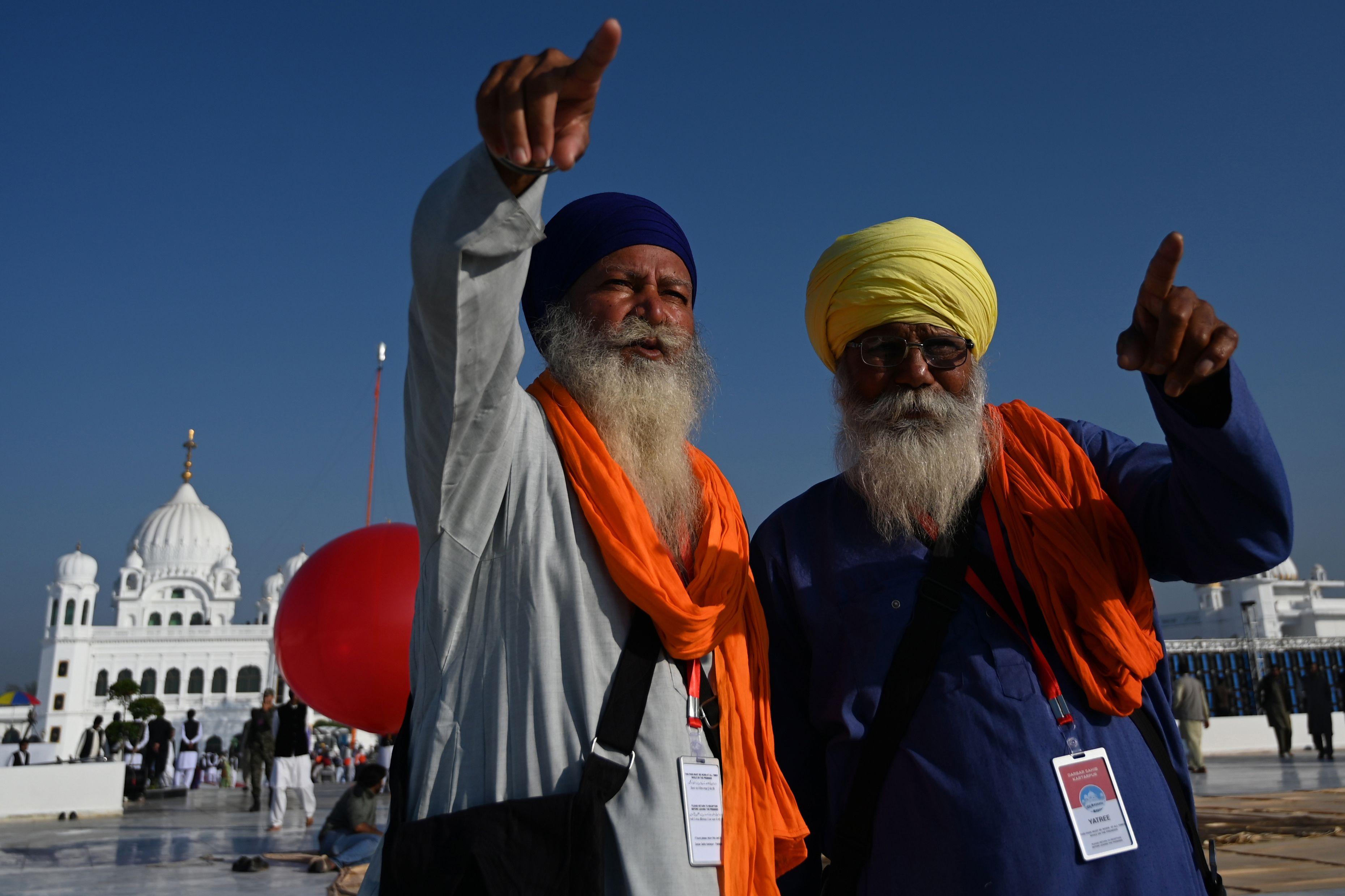 Sikh pilgrims point at the inauguration site of the Shrine of Baba Guru Nanak Dev at Gurdwara Darbar Sahib in Kartarpur. Photo: AFP
