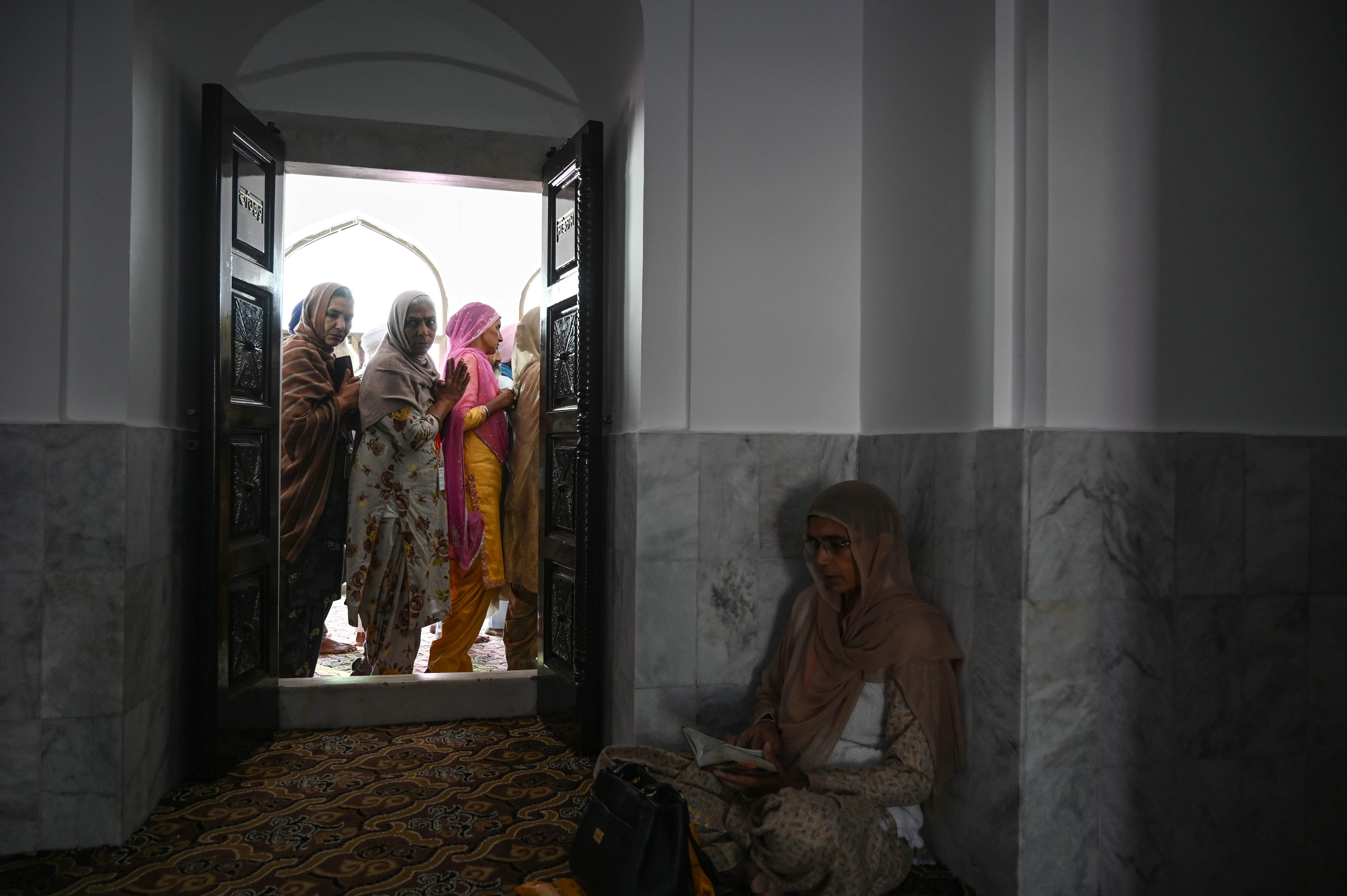 Sikh pilgrims visit the Shrine of Baba Guru Nanak Dev at Gurdwara Darbar Sahib in Kartarpur. Photo: AFP