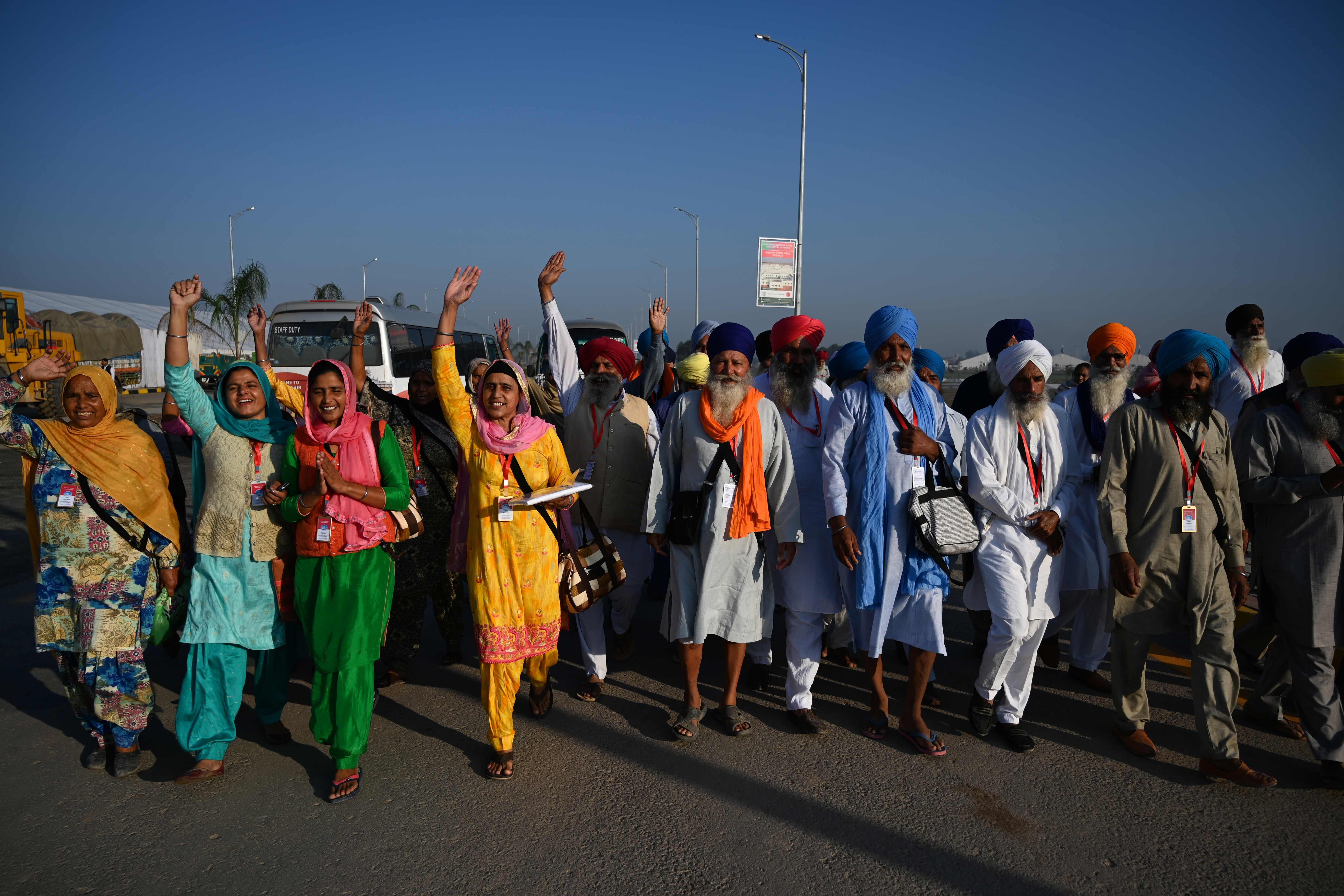 Sikh pilgrims shout slogans as they arrive to visit the Shrine of Baba Guru Nanak Dev at Gurdwara Darbar Sahib in Kartarpur. Photo: AFP