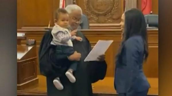 Judge holds baby as mom is sworn in as lawyer