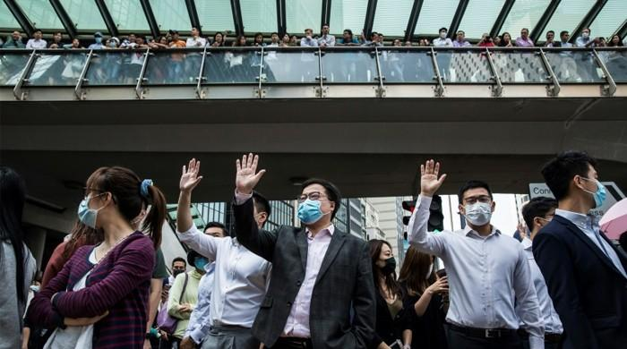 Hong Kong protesters defy Xi with pro-democracy rallies