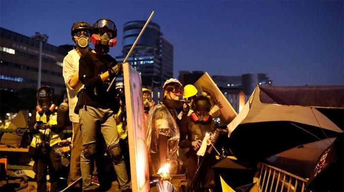 Hong Kong campus protesters fire arrows as unrest spreads across Kowloon