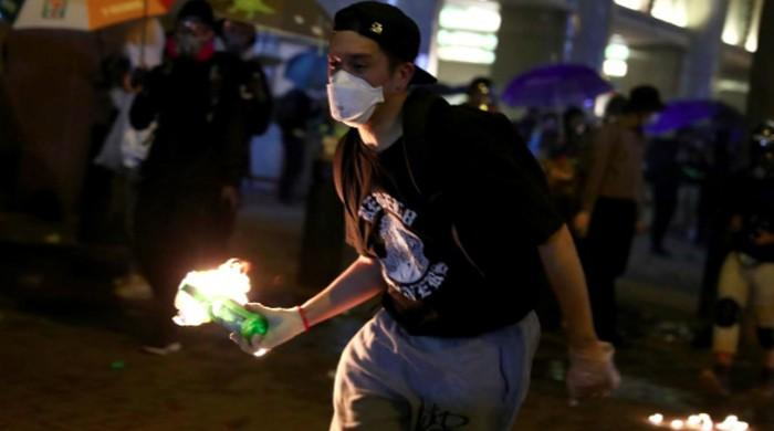 Hong Kong protesters confront police to try to free campus allies