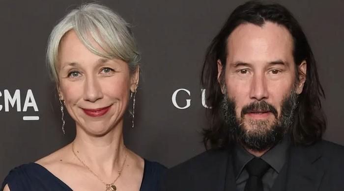 Keanu Reeves' girlfriend keeps her grey hair for a reason