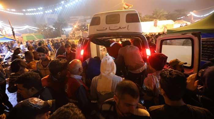 Twelve protesters killed in Baghdad attack as US imposes new sanctions
