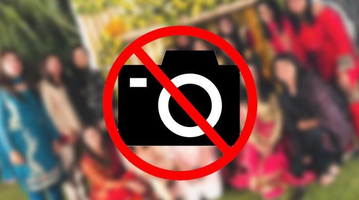 Guests throw hands over taking pictures of women in Peshawar wedding