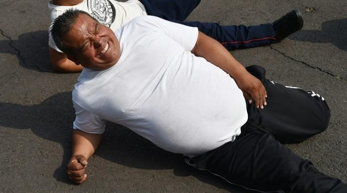 Drop that doughnut! Mexico pays portly cops to 'be in optimal condition'