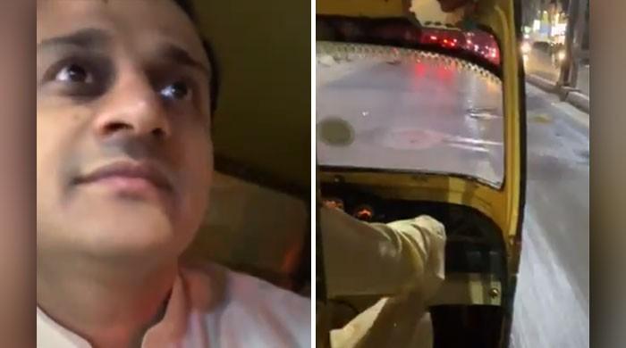 Sindh CM's advisor Murtaza Wahab enjoys a rickshaw ride in Karachi