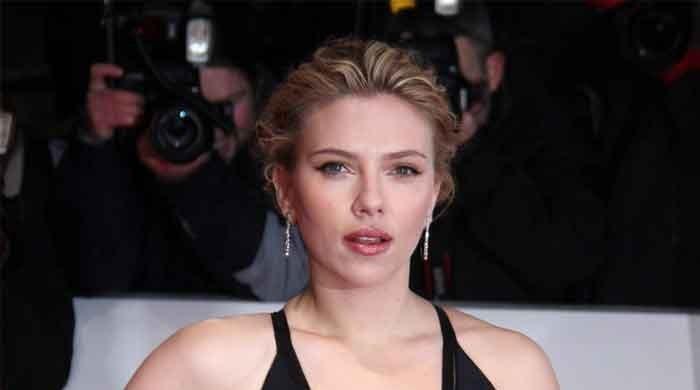 Scarlett Johansson hosts SNL, cracks jokes about fiancé Colin Jost