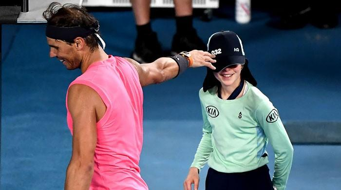 Rafael Nadal apologises to ballgirl with kiss on cheek after a shot hits her