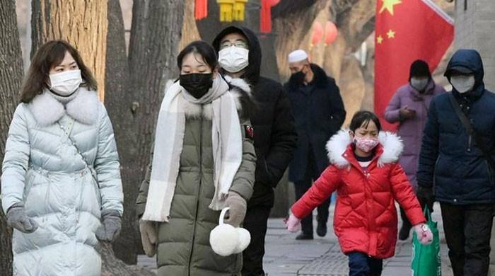 China fortifies virus defences as deaths hit 56
