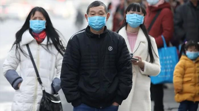 Chinese health official confirms new virus 'not as powerful as SARS'