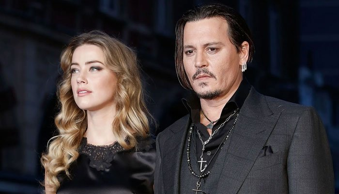 Amber Heard 'admits to hitting' Johnny Depp with pots, pans