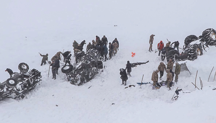 Eight rescue workers are killed and 20 others are buried in avalanche