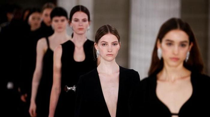 Victoria Beckham's black dresses stage 'gentle rebellion' at London Fashion Week