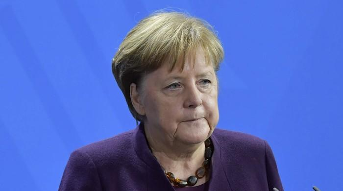 Racism, hatred 'a poison' in society, says Merkel after German mass shootings